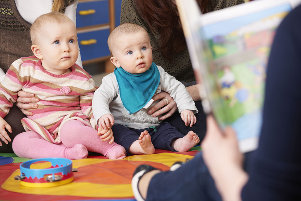 image of Baby reading book