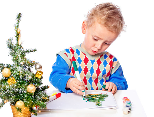 boy drawing a Christmas tree