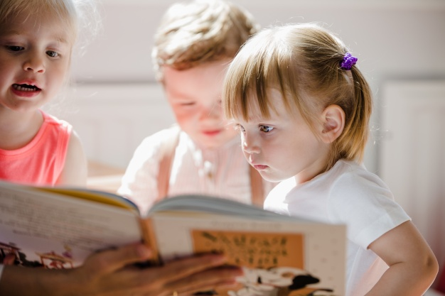 Image of children reading book